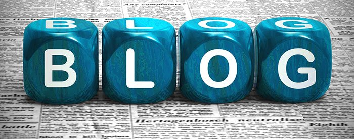 Blog with building blocks spelled out on top of newsprint